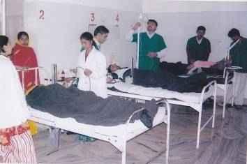 Doctors Visiting Patients at the Prem Raghu Hospital