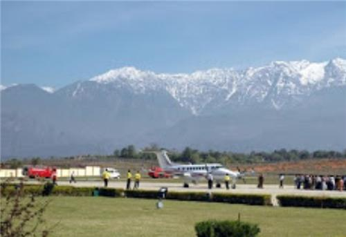 Gaggal Airport with Dhauladhar at the Background