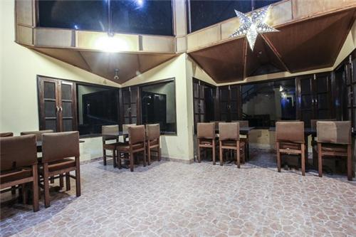 Well set restaurant at Winnies Holiday Inn in Kasauli