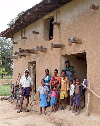 Oraon Family Outside Their Home