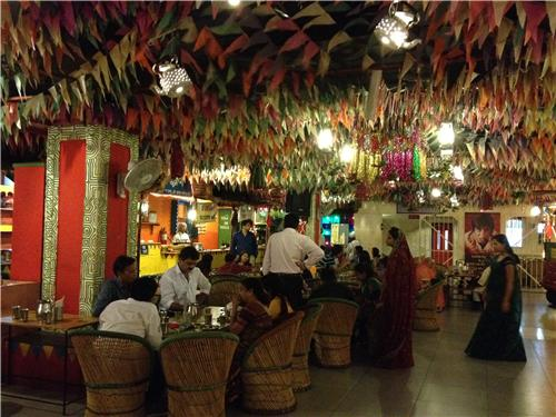 People enjoying food and fun at Village restaurant