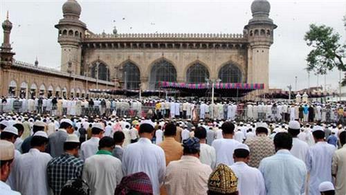 People celebrating Bakrid at Mecca Masjid