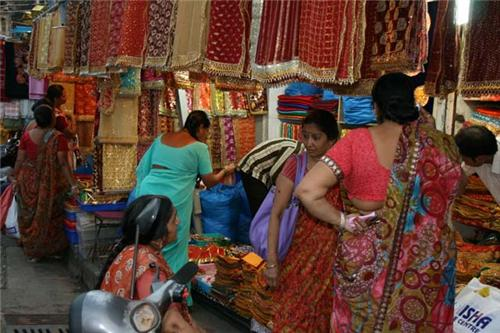 Buyers at saree shop in mangaldas market.