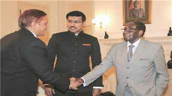 Rathore meets Mugabe, extends invitation for Africa summit