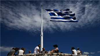 Greece defaults to IMF