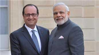 Hollande welcomes Modi at CoP 21