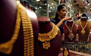 Gold surges by Rs 155 on jewellers' demand