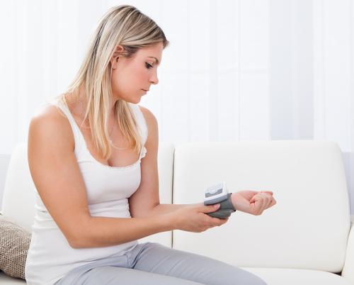 woman-measuring-her-blood-pressure