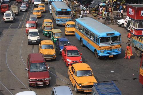 Travel and Transport (Source: https://en.wikipedia.org/wiki/File:Traffic_in_Kolkata.jpg)