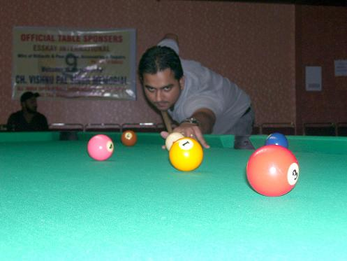 Playing snooker at Mohali Club