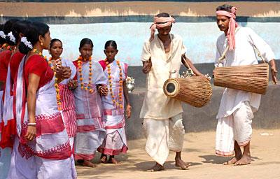 Ladies in Red Bordered Sarees