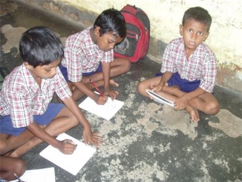 Santhali Children Engrossed in Studies