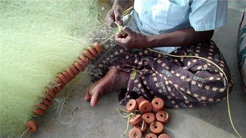 Fisherman at Work in Pondicherry Fishing Village