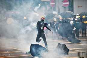 Hong Kong Police fired gun, used water cannon on protesters