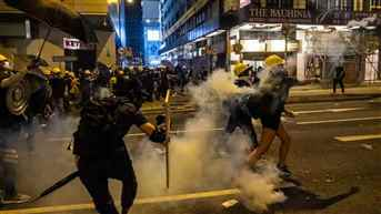 Hong Kong Police fire tear gas and rubber bullets at protesters